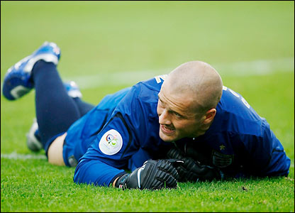 Paul Robinson grimaces after falling awkwardly but recovers after treatment