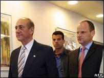 Israeli Prime Minister Ehud Olmert (left) enters cabinet meeting in wake of Palestinian raid
