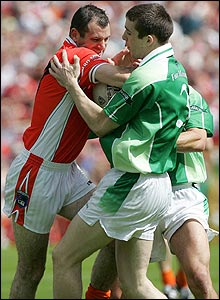 Steven McDonnell of Armagh comes up against Barry Owens