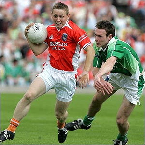 Paul Duffy of Armagh is chased by Fermanagh's James Sherry