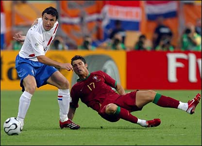 Holland's Mark van Bommel and Cristiano Ronaldo