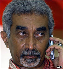 East Timorese Prime Minister Mari Alkatiri listens to his phone during a press conference in Dili 25 June 2006.