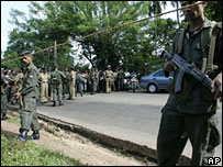 Sri Lanka army soldiers secure the site of suicide bombing that killed Maj Gen Parami Kulatunga