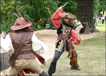 Two pirates having a swordfight