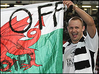 Lee Trundle waves the offending flag after Swansea's cup win at the Millennium Stadium