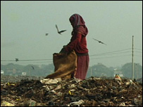 A woman scrounging on a rubbish dump near Dhaka, Bangladesh