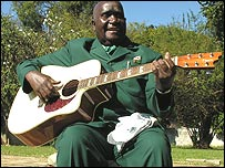 Kenneth Kaunda playing guitar