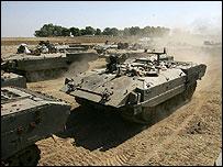 Israeli armoured vehicles stationed outside Gaza