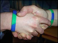 Hands with anti-sectarian bracelets