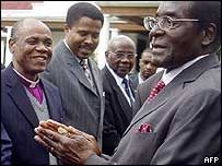 President Robert Mugabe, with church leaders last month