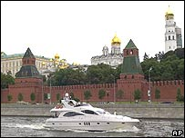 A boat sails on the Moscow River, past the Kremlin