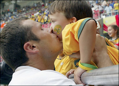 Australia striker Mark Viduka kisses his son Joey