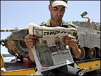 Israeli tank being transported to Gaza border