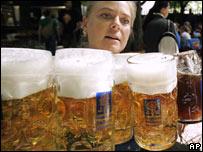 Woman serving German beer