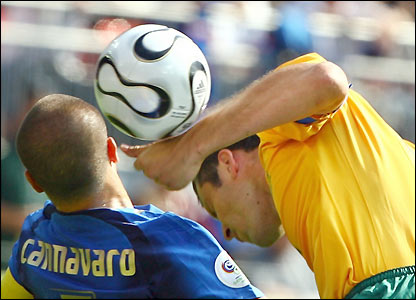 Mark Viduks battles with Fabio Cannavaro