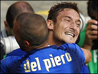 Francesco Totti is embraced by team-mate Alessandro del Piero after scoring the penalty that sent Italy into the World Cup quarter-finals