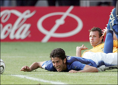 Fabio Grosso is fouled by Lucas Neill