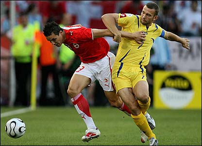 Ukraine's Andriy Shevchenko and Philipp Degen