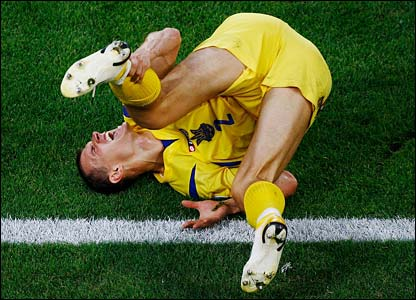 Ukraine's Andriy Nesmachniy in agony on the pitch