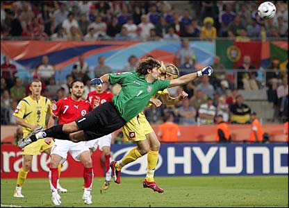 Ukrainian keeper Olexandr Shovkovskiy punches clear