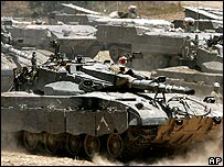 Israeli tanks mass on border