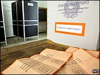 Ballot papers are seen in a polling station in central Rome, 25 June 2006