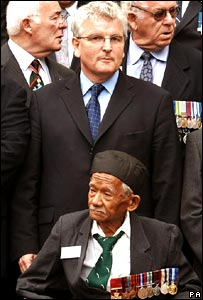 Defence Secretary Des Browne stands behind Captain Lachhiman Gurung VC (Victoria Cross),