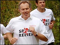Tony Blair completes a mile for Sport Relief in Stratford east London