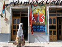 an Eritrean woman walks past a bar with a decoration to celebrate the liberation of Asmara from Ethiopian soldiers some 15 years ago