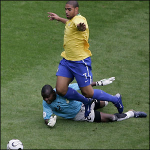 Adriano goes down in the penalty area