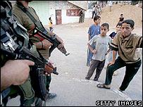 Militants and children in Gaza
