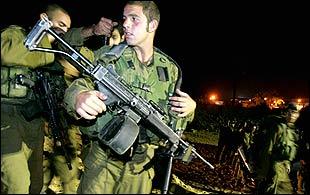 Israeli troops prepare to enter Gaza