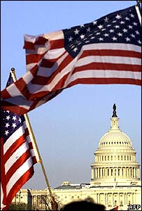 People wave US flags in front of Capitol Hill