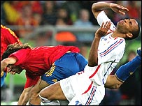 Thierry Henry [right] after clashing with Carles Puyol