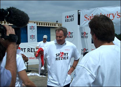 Tony Blair proudly brandishes his second red sock, which is awarded to everyone who goes the extra mile for Sport Relief