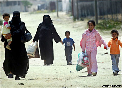 A Palestinian family evacuates their home close to Gaza International Airport