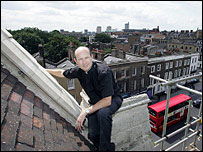 Father Malcolm Hunter on church roof