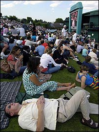 The crowd on Henman Hill sample the atmosphere