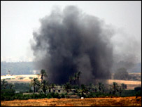 Smoke after an explosion in a village of Beit Hanoun