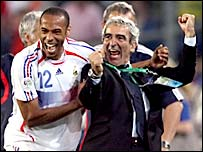 Thierry Henry and Raymond Domenech celebrate France's win over Spain