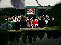 Fans watch Andy Murray on Henman Hill