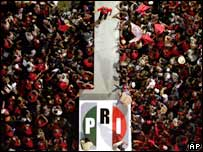 Roberto Madrazo walks along a platform amid supporters at his final campaign rally