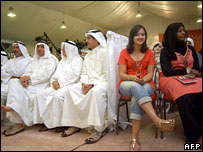 Kuwaitis attend a parliamentary election rally in Dahiyet Abdullah al-Salem in Kuwait City on Monday