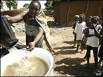 African woman collecting water