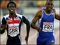 Malcolm (left) gets the better of 100m champion Ronald Pognon
