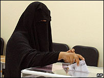 A Kuwaiti woman casts her vote at a polling station in Salwa, Kuwait City