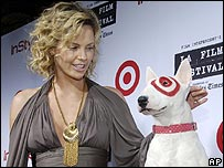 Charlize Theron with Bullseye, mascot of the Target Filmmaker Awards