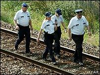 Police found the bodies near a railway track in Liege