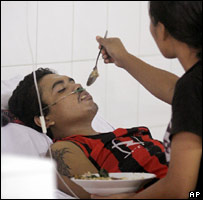 Bird flu survivor Johannes Ginting, from Indonesia, is treated in hospital (AP)