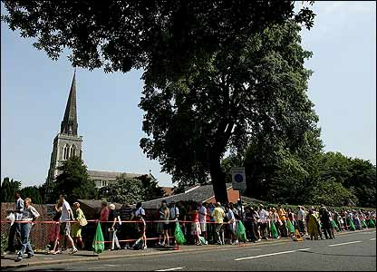 A queue of fans snakes past St Mary's church in Wimbledon